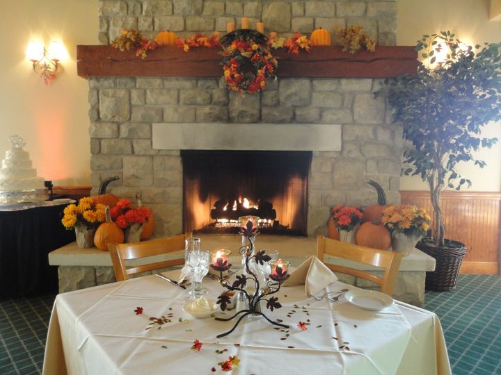 Our two-story stone fireplace is a great backdrop for your sweetheart table. Especially in the Fall...