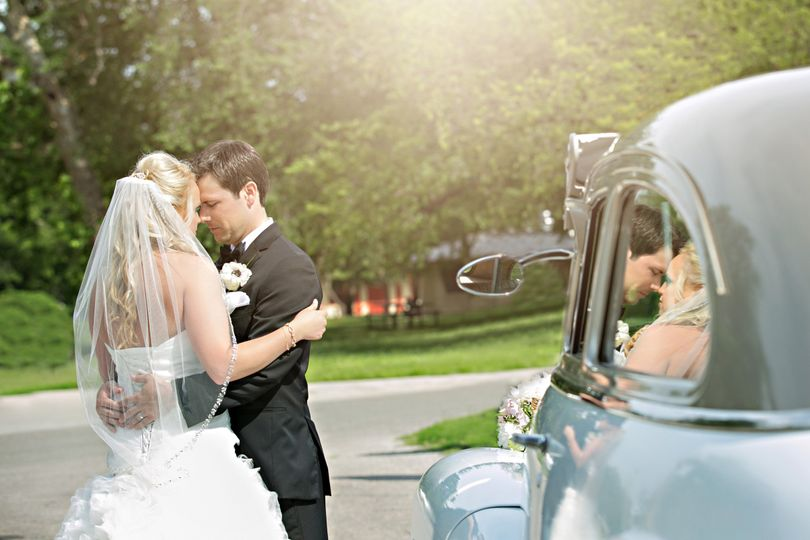 bride and groom reflection classic car