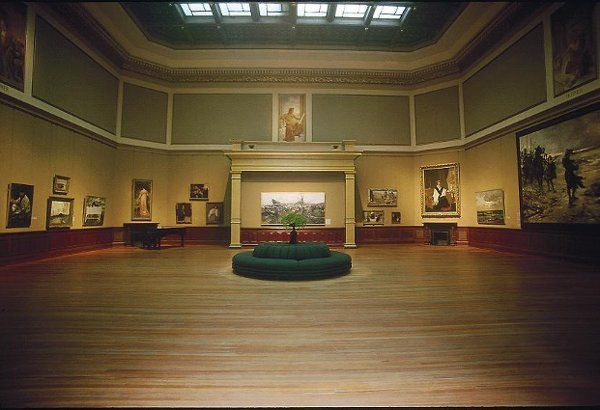 Added to the house museum in 1890, the Telfair's Rotunda space is a dark wood paneled wall lined...
