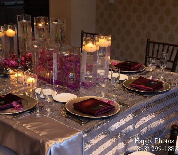 Silver wedding charger plates rental, silver sequin overlay, plum satin napkins, bella event...