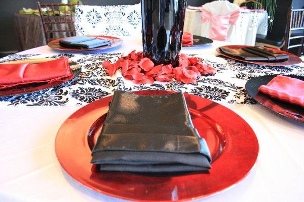 Red charger plates rental wedding rental, black satin napkins rental, Bella Event Services, Costa...
