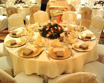 $1 Gold charger plates, ivory chair covers, christmas party, gold sashes, chair cover rental orange...