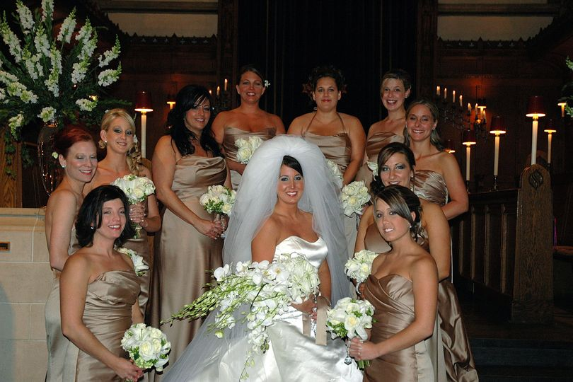 Bridesmaids around their bride