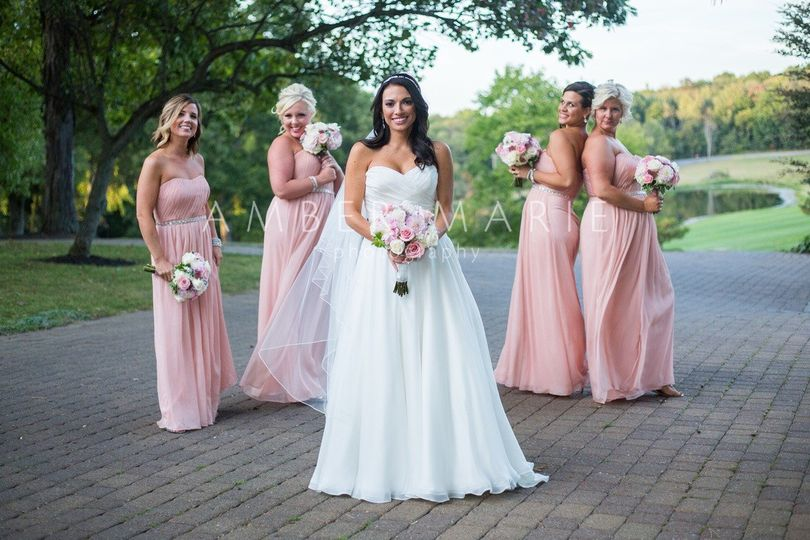 Bride with her bridesmaids behind her