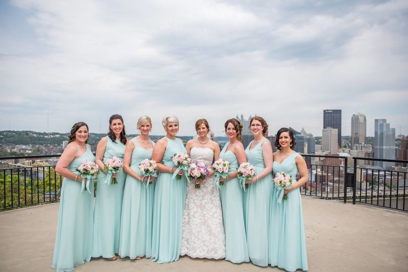 Bride and bridesmaids with bouquets in hand
