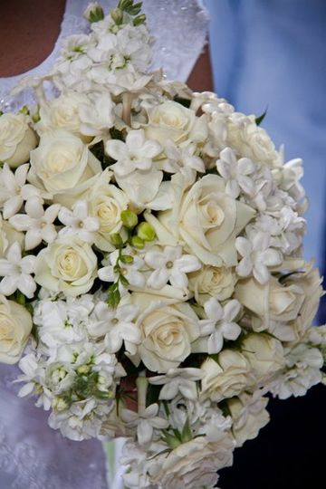 Classic fragrant bridal bouquet with roses, stephanotis and stock