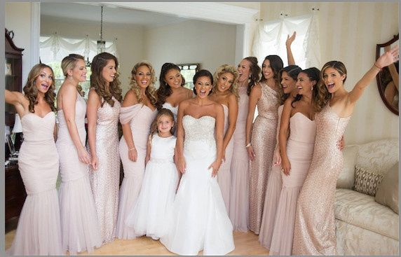 Bridemaids wearing blush dresses by Amsale Bridesmaids in tulle and sequin