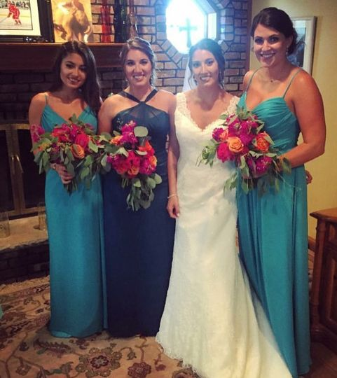 Bridesmaids styled in Bari Jay and Hayley Paige Occasions in aqua and blue