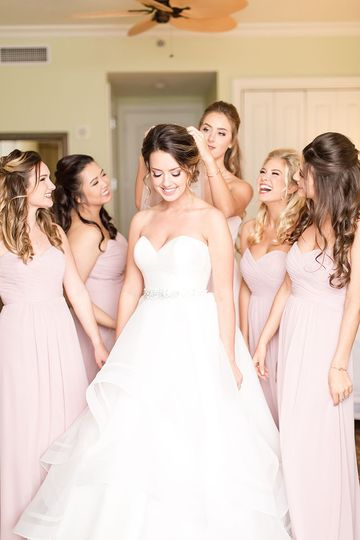 With a little help from the bridesmaids