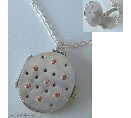 Sterling Silver and Copper locket.  Isabel Jewelry makes custom lockets.  Each one is one of a...