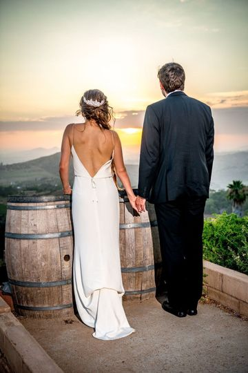 Low back line wedding dress and classic tuxedo
