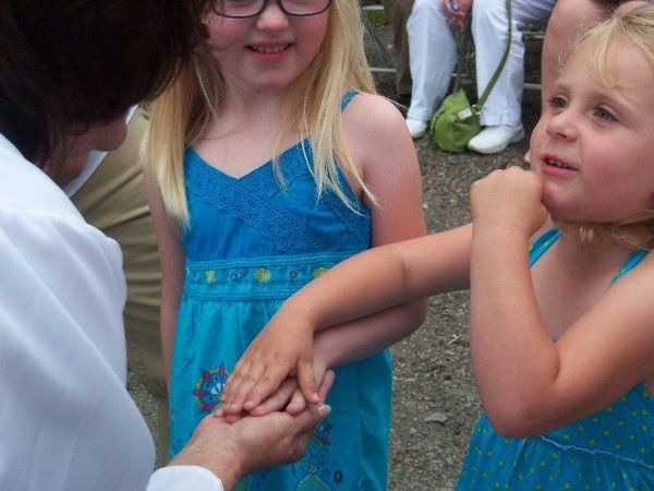 Flower girls with the officiant
