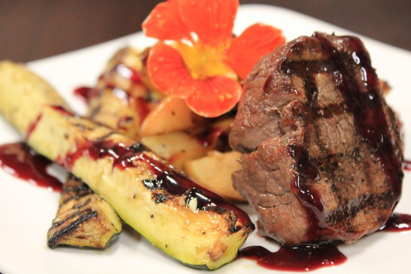 grilled painted hills beef tenderloin steaks with grilled summer zucchini spears roasted apple potato onion medley 8 51 633402 1564511968