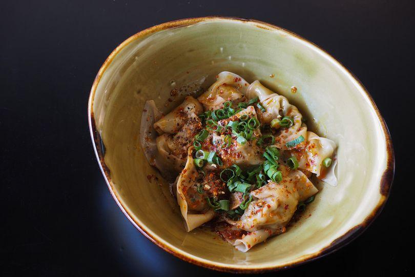 Sichuan 'working hands' dumplings, sesame butter, peppercorn-chili broth