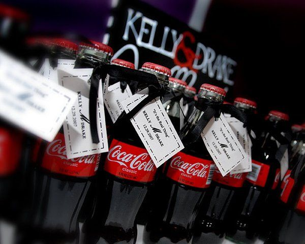 Guests at Kelly & Drake's wedding took home glass coca cola bottles with tags