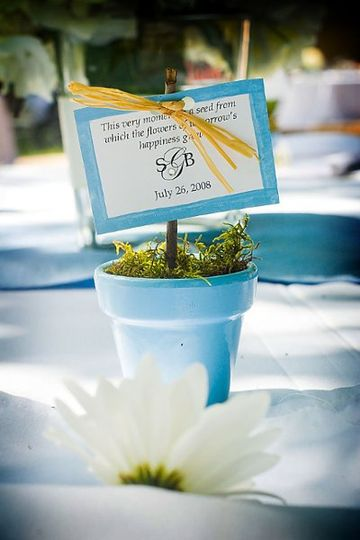 Guests at Bob & Susan's wedding each took home a small pot, painted in their wedding colors with...