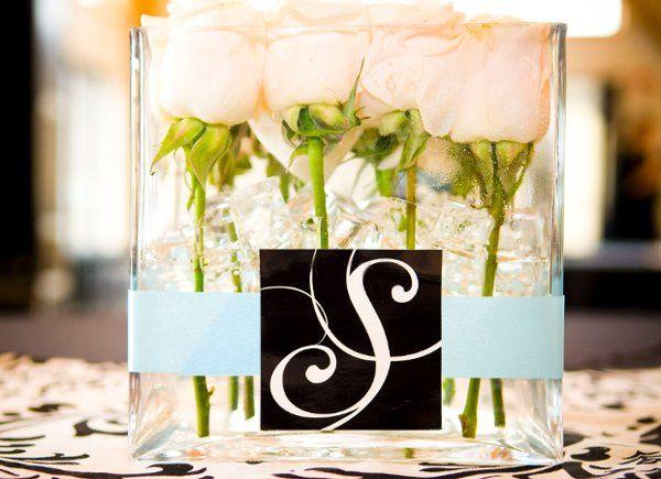 Rachel & Matt's wedding was designed around their wedding logo, created by the bride herself, also a...