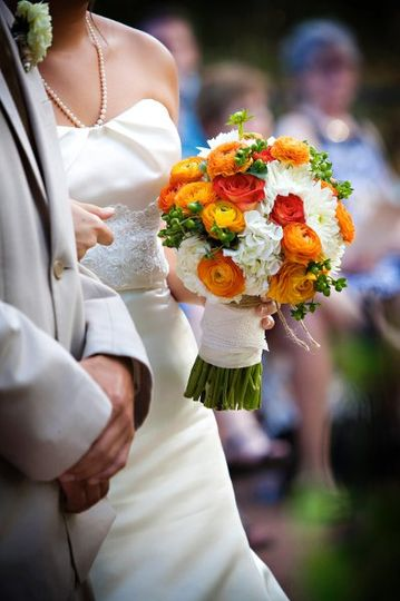 Finishing Touch created Molly's bouquet around her Rustic Southern theme. It consisted of white...