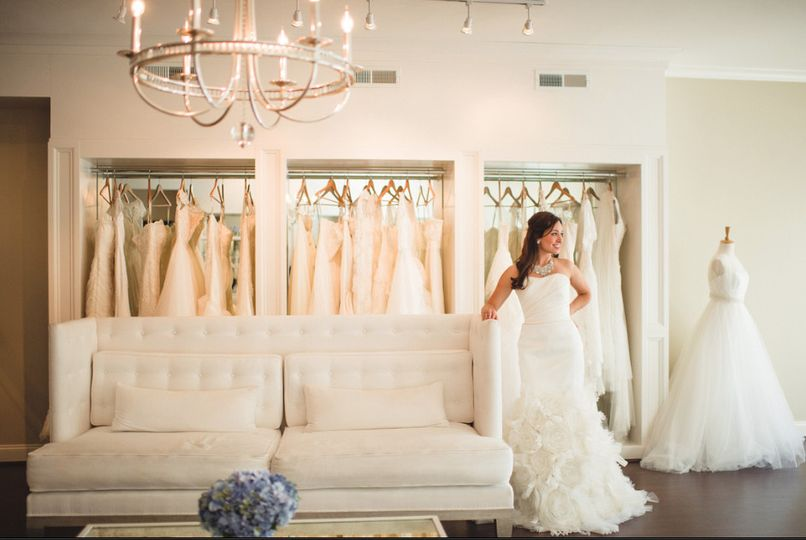 Bride-to-be in a warmly lit showroom