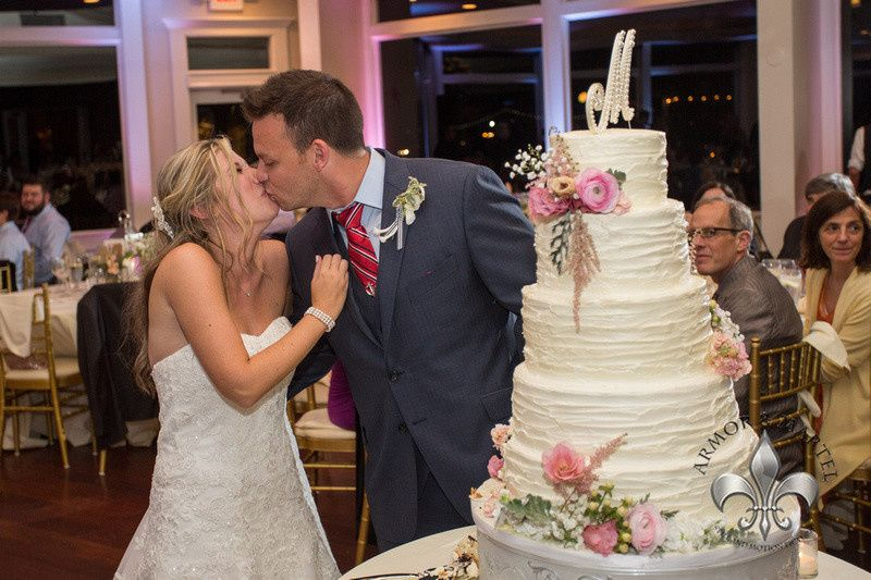 Couple kiss by the cake