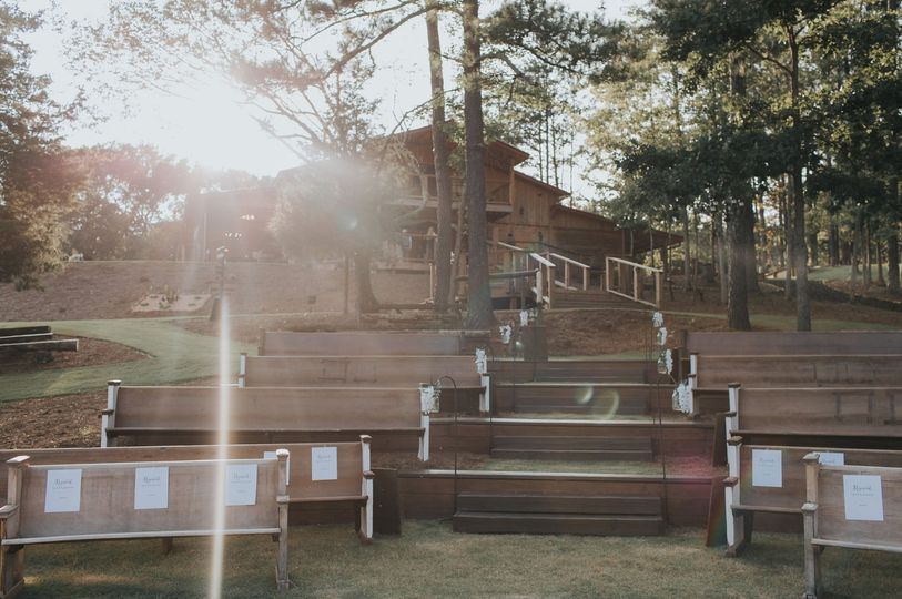 View of ceremony seating area up to reception barn