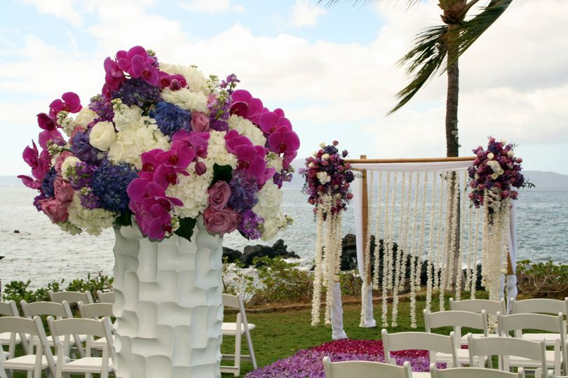 Tall Vases on Pedestals Mark the Entrance to the Aisle