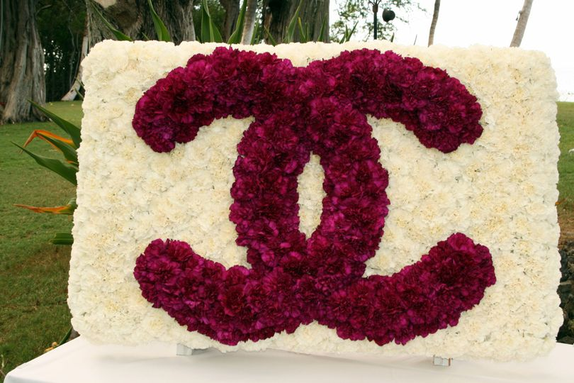 A Custom Monogram in live flowers to Accessorize the dance floor