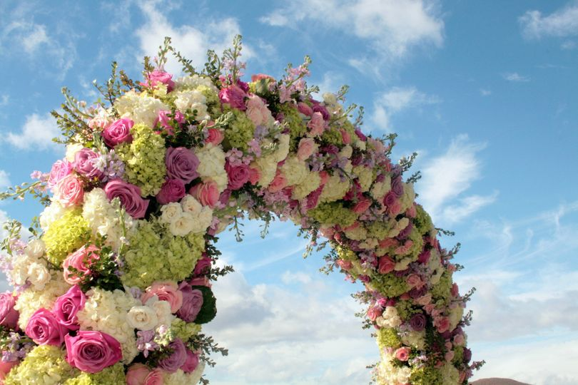 A Floral Arch of Hydrangea, Stock and Roses etc.