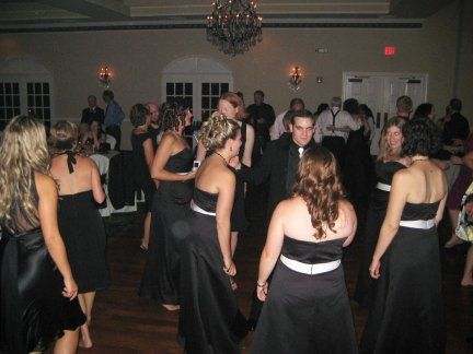 The couple with their guests dancing