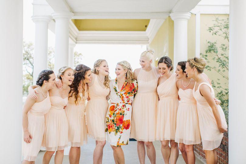 Bride and bridesmaids sharing laughs