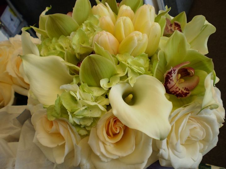 Green hydrangea, mini callas, tulips, green orchids, roses