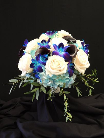Bridal bouquet with blue hydrangea, blue orchids, vendela roses, purple mini callas