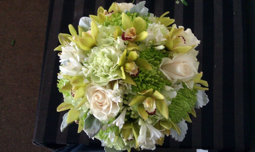 Green orchids, green spiders, ivory roses, hydrangea