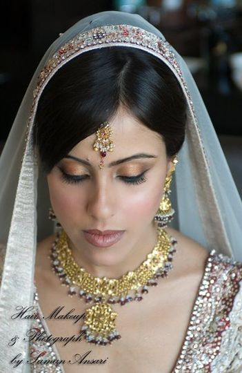 An Elegant Indian Wedding Ceremony Look with enhanced naturals as the color palette.