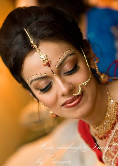 Traditional Indian wedding hair and makeup look.