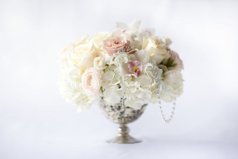glam centerpiece pink and white mercury pops of pl