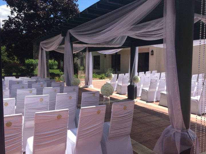 Outdoor setup | Decor: Chalet FloralChair Covers: Sitting Pretty