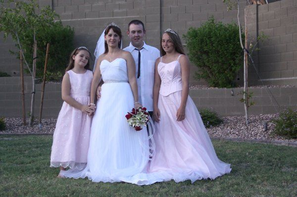 Posing for the camera with the bridesmaids.