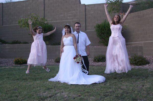 The bridesmaids jumping for joy.