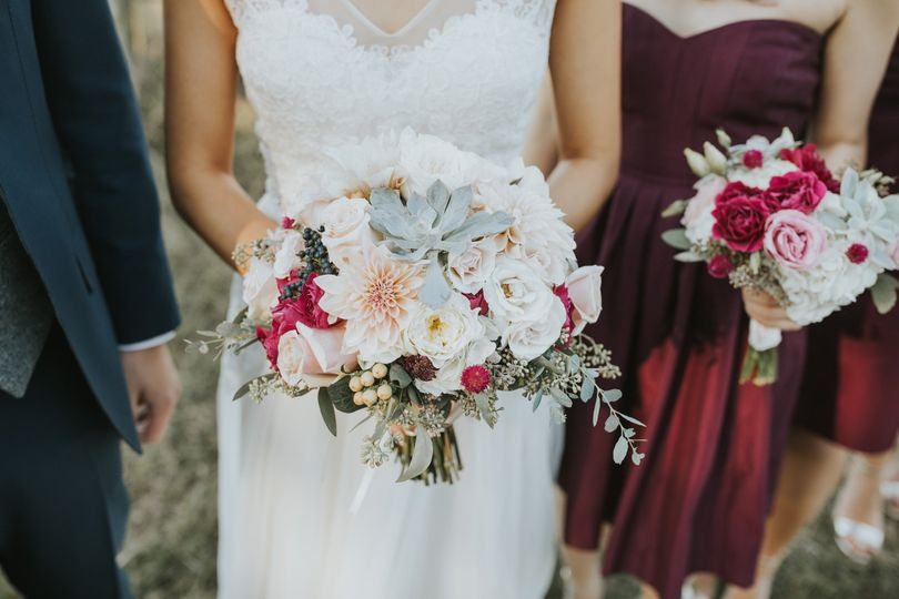 Natural style hand tied bouquet featuring hot pink, peach and blush pink blooms - roses, spray...