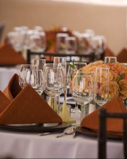 Table setup with orange flower centerpiece