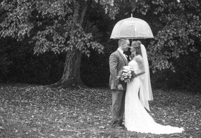 Newlyweds share an umbrella