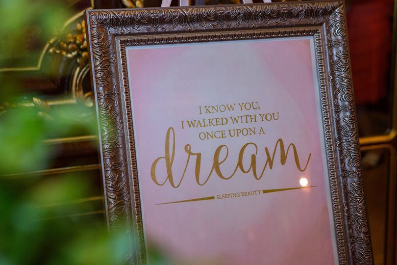 A fairy tale wedding complete with quote signs from the romance of Disney movies, including this one...