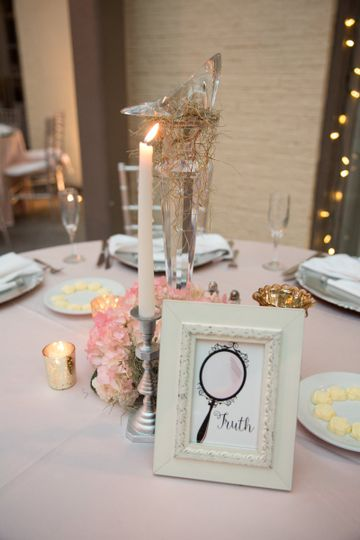 A fairy tale wedding isn't complete without table markers with symbols of storybook love!