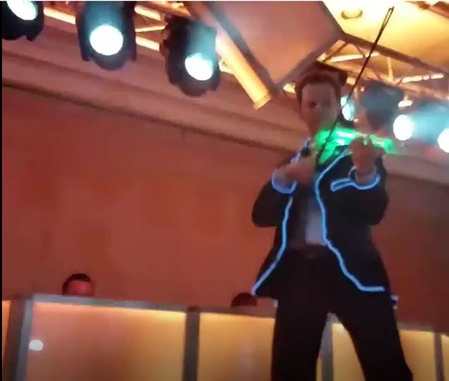 Electric led violinist performs as a dj violinist at a wedding with dmx controlled moving heads, dj...