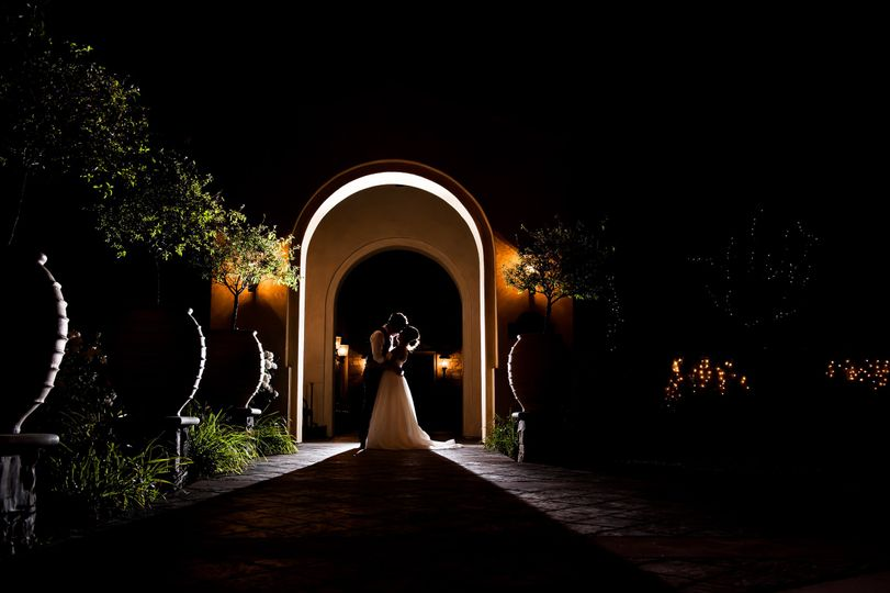 Couple under an archway at night