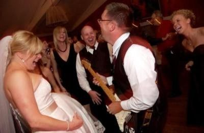 Bride and her air guitar!