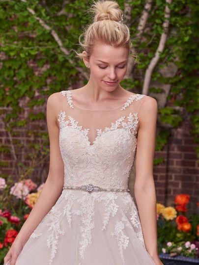 Maggie Sottero Rebecca Ingram Style: OLIVIA  A lace bodice and illusion bateau neckline add romance...
