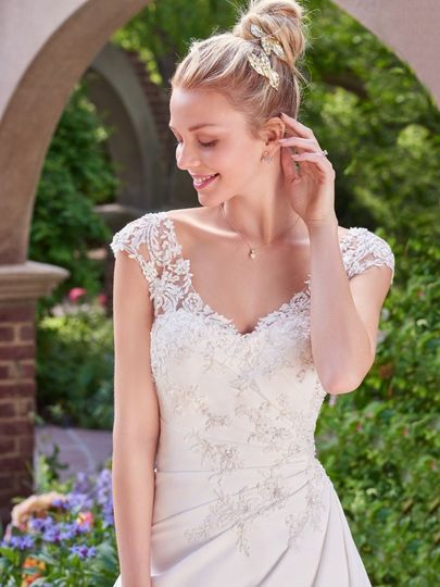 Maggie Sottero  Rebecca Ingram Style: SIGRID   Asymmetrical pleating and shimmering lace add touches...