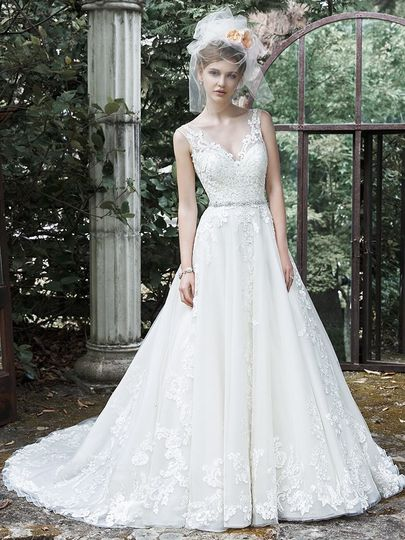 Maggie Sottero Style: SYBIL  This exquisite ball gown wedding dress is complete with floral lace...